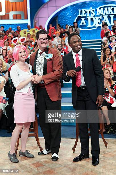 Valentine's Day Episode Renee Smith of Los Angeles and her husband Scott are focused on a curtain opening as Host Wayne Brady looks on a special...