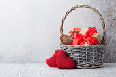 Valentine's day greeting card with gift boxes in basket. With space for your greetings