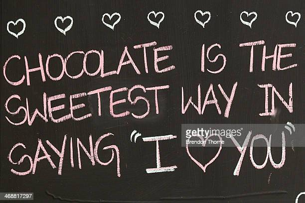 Valentine's Day sign is displayed outside a chocolate shop as Sydneysiders prepare for Valentine's Day on February 12 2014 in Sydney Australia St...