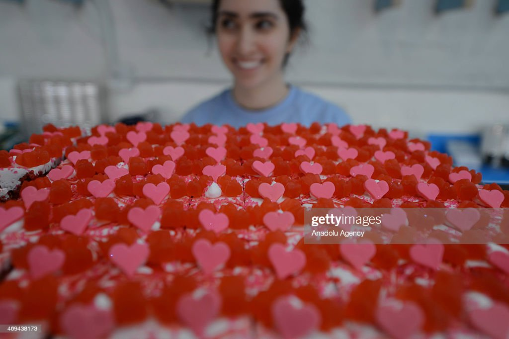 Valentine's Day treats with 'hearts' and 'I love yous' on top, attract people's attention at the sweet shop in New York City on February 14, 2014 .