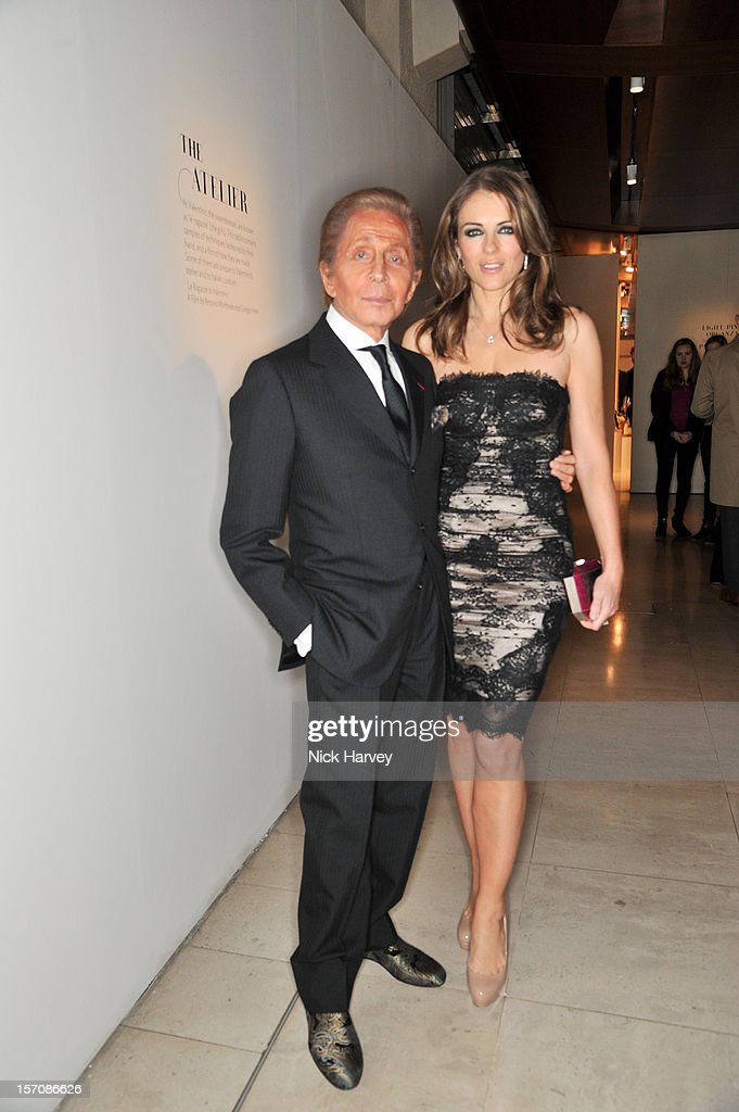 Valentino and <a gi-track='captionPersonalityLinkClicked' href=/galleries/search?phrase=Elizabeth+Hurley&family=editorial&specificpeople=201731 ng-click='$event.stopPropagation()'>Elizabeth Hurley</a> attend the VIP view of Valentino: Master of Couture at Embankment Gallery on November 28, 2012 in London, England.