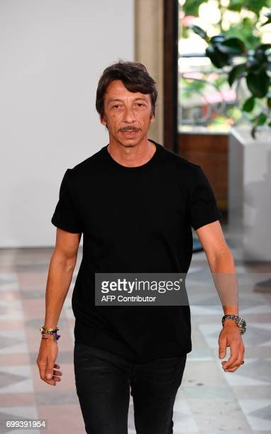 Valentino creative director Pierpaolo Piccioli acknowledges the audience after the Men's Fashion Week for the Spring and Summer 2018 collection in...