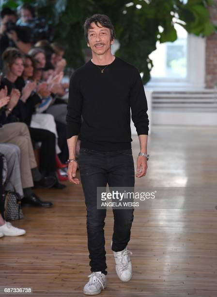 Valentino creative director Pierpaolo Piccioli salutes the members of the audience the Valentino Resort 2018 runway show on May 23 2017 in New York...