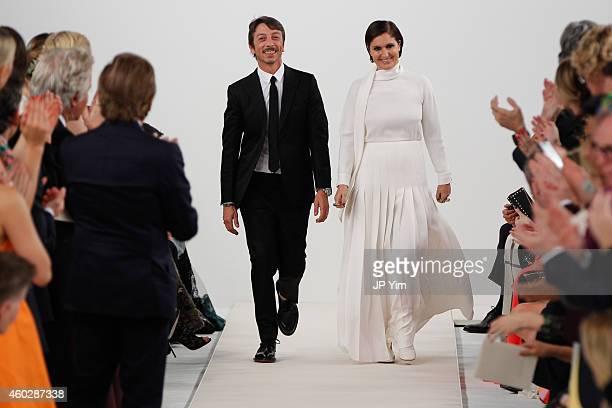 Valentino Creative Directors Pierpaolo Piccioli and Maria Grazia Chiuri walk the runway during the Valentino Sala Bianca 945 Event on December 10...