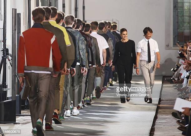 Valentino designers Maria Grazia Chiuri and Pier Paolo Piccioli acknowledges the applause of the public during the Valentino Spring/Summer 2013...