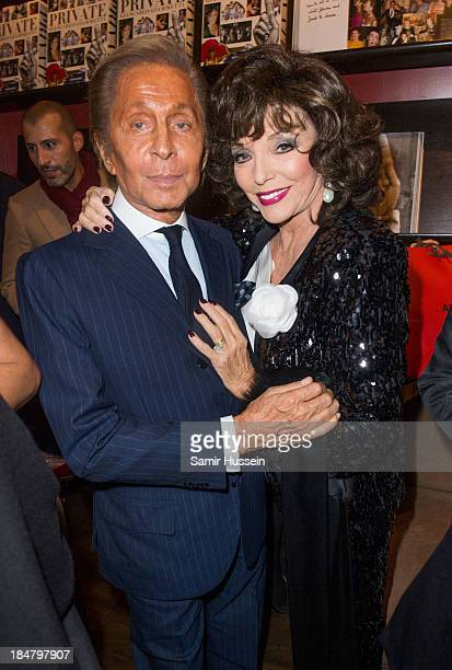 Valentino Garavani and Joan Collins pose at 'Private Giancarlo Giammetti' Book Launch hosted by Assouline at Claridge's Hotel on October 16 2013 in...