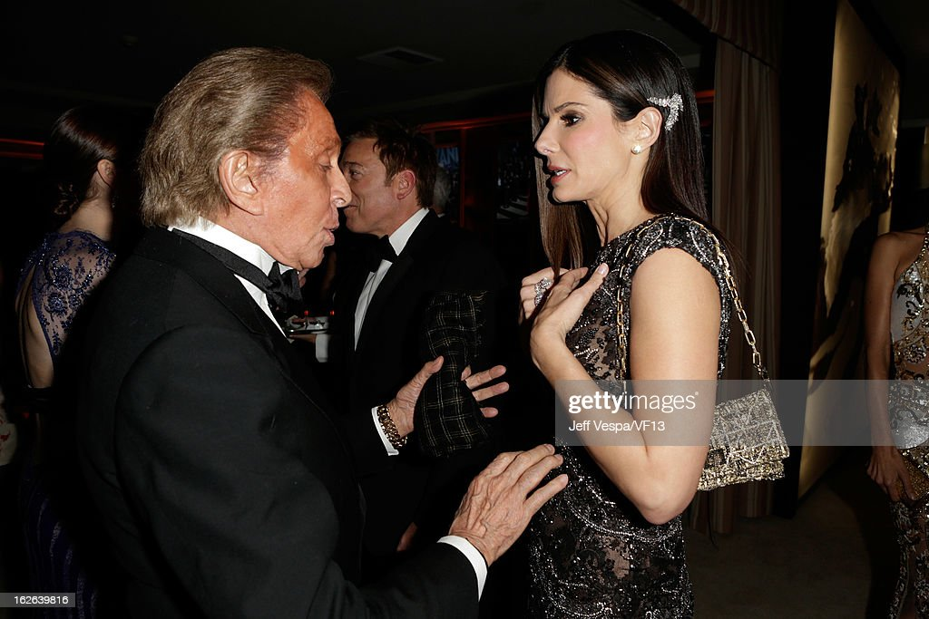 Valentino Garavani (L) and Sandra Bullock attend the 2013 Vanity Fair Oscar Party hosted by Graydon Carter at Sunset Tower on February 24, 2013 in West Hollywood, California.