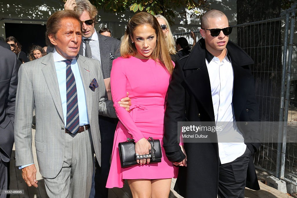 Valentino Garavani, <a gi-track='captionPersonalityLinkClicked' href=/galleries/search?phrase=Jennifer+Lopez&family=editorial&specificpeople=201784 ng-click='$event.stopPropagation()'>Jennifer Lopez</a> and Casper Smart arrive at theValentino Spring / Summer 2013 show as part of Paris Fashion Week at Espace Ephemere Tuileries on October 2, 2012 in Paris, France.