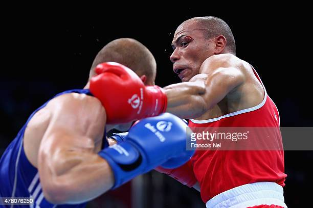 Valentino Manfredonia of Italy and Dzemal Bosnjak compete in the Men's Boxing Light Heavy 81 kg quarter finals during day ten of the Baku 2015...