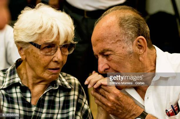 Valentino Parlato kisses the hand of Carla Ravaglioli hand former Independent Left Senator the during assembly in defense of the Constitution on...