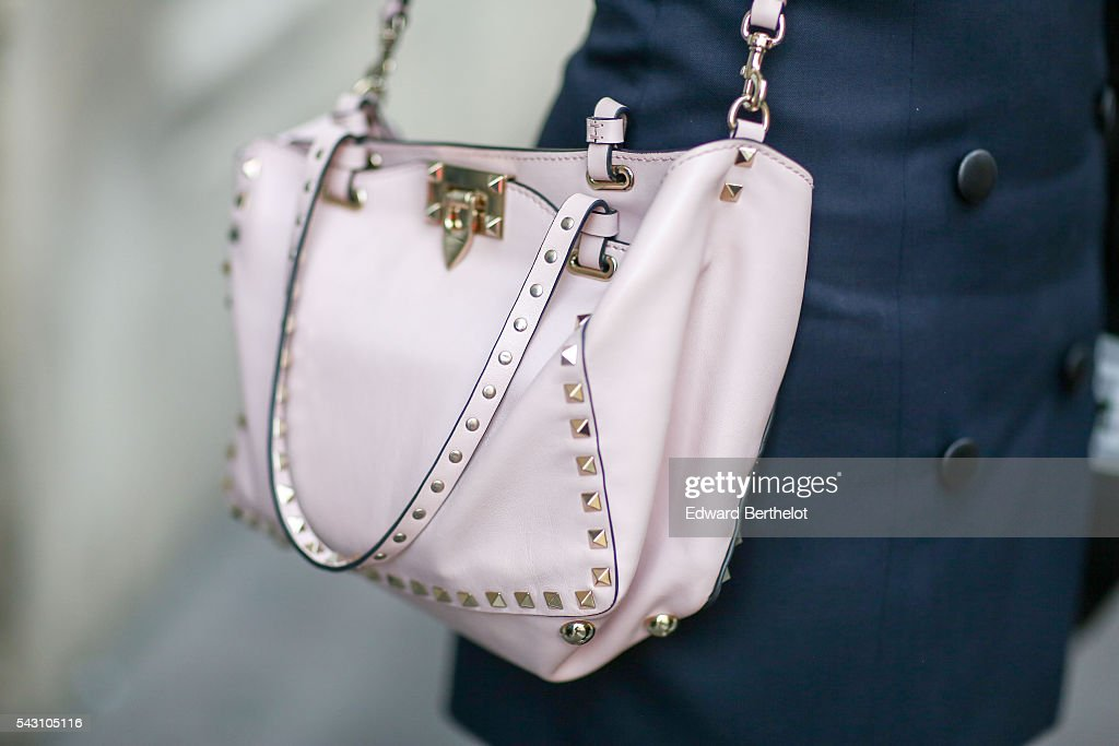 A Valentino pink bag is seen, after the Hermes show, during Paris Fashion Week Menswear Spring/summer 2017, on June 25, 2016 in Paris, France.