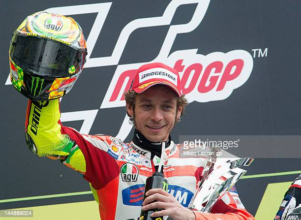 Valentino Rossi of Italy and Ducati Marlboro Team celebrates on the podium after finishing in second place at the end of the French MotoGP race on...