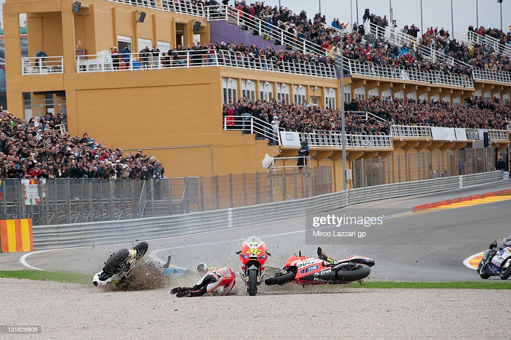 <a gi-track='captionPersonalityLinkClicked' href=/galleries/search?phrase=Valentino+Rossi&family=editorial&specificpeople=157603 ng-click='$event.stopPropagation()'>Valentino Rossi</a> of Italy and Ducati Marlboro Team crashed out in the first corner of first lap with Alvaro Bautista of Spain and Rizla Suzuki MotoGP, Randy De Puniet of France and Pramac Racing Team and <a gi-track='captionPersonalityLinkClicked' href=/galleries/search?phrase=Nicky+Hayden&family=editorial&specificpeople=227346 ng-click='$event.stopPropagation()'>Nicky Hayden</a> of USA and Ducati Marlboro Team during the MotoGP race of the MotoGP of Valencia at Ricardo Tormo Circuit on November 6, 2011 in Valencia, Spain.