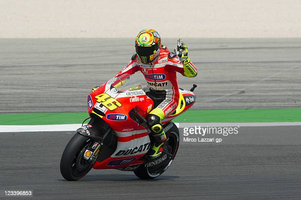 Valentino Rossi of Italy and Ducati Marlboro Team greets the fans at the end of the free practice of MotoGP of San Marino at Misano World Circuit on...