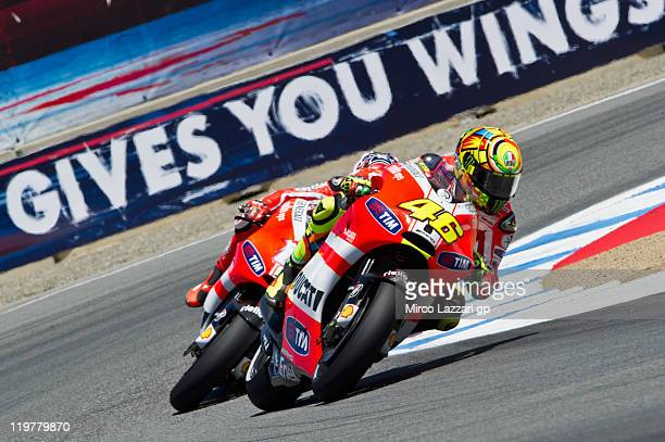 Valentino Rossi of Italy and Ducati Marlboro Team leads Nicky Hayden of USA and Ducati Marlboro Team during the MotoGP race of Red Bull US Grand Prix...