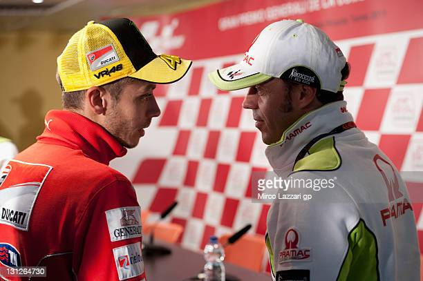 Valentino Rossi of Italy and Ducati Marlboro Team speaks with Loris Capirossi of Italy and Pramac Racing Team during the press conference preevent of...