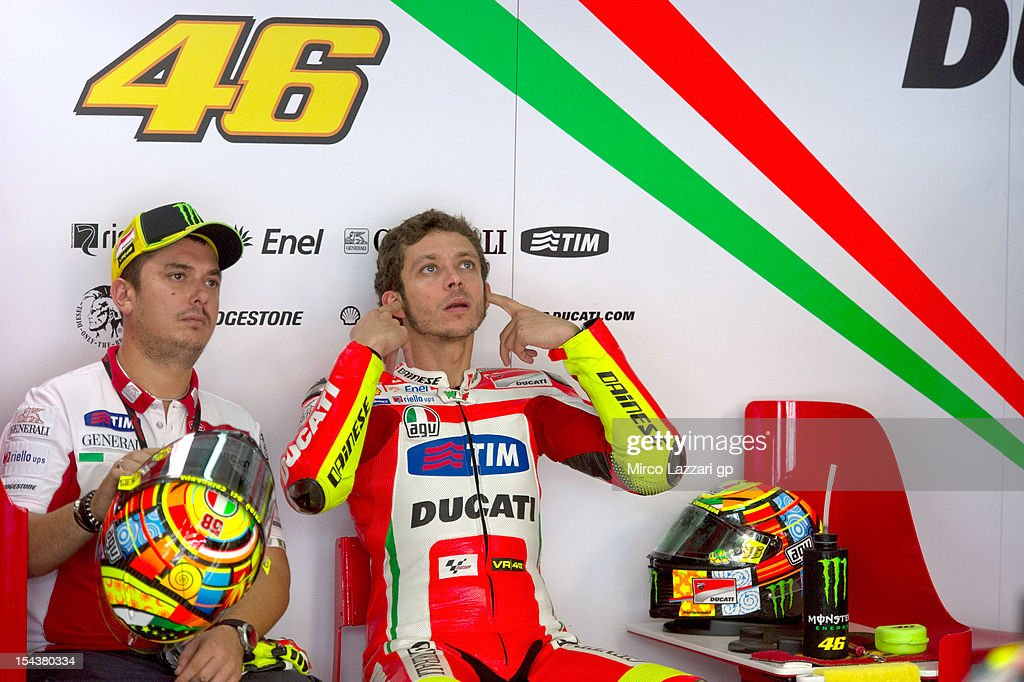 <a gi-track='captionPersonalityLinkClicked' href=/galleries/search?phrase=Valentino+Rossi&family=editorial&specificpeople=157603 ng-click='$event.stopPropagation()'>Valentino Rossi</a> of Italy and Ducati Marlboro Teamprepares to start in the pit garage during the free practice of the MotoGP Of Malaysia at Sepang Circuit on October 19, 2012 in Kuala Lumpur, Malaysia.
