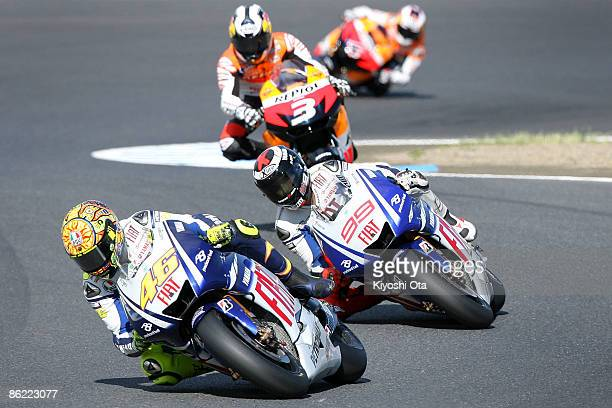 Valentino Rossi of Italy and Fiat Yamaha Team in action with Jorge Lorenzo of Spain and Fiat Yamaha Team Dani Pedrosa of Spain and Repsol Honda Team...