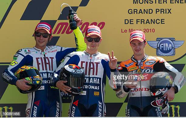 Valentino Rossi of Italy and Fiat Yamaha Team Jorge Lorenzo of Spain and Fiat Yamaha Team and Andrea Dovizioso of Italy and Repsol Honda Team...