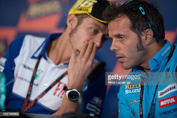 Valentino Rossi of Italy and Fiat Yamaha Team speaks with Loris Capirossi of Italy and Rizla Suzuki MotoGP during the press conference preevent of...
