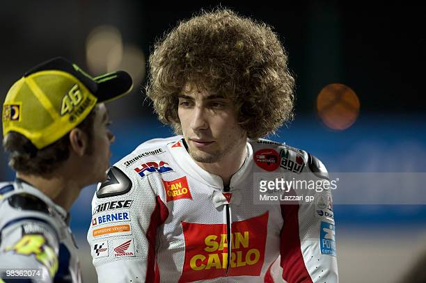 Valentino Rossi of Italy and Fiat Yamaha Team speaks with Marco Simoncelli of Italy and San Carlo Honda Gresini during the official photo session at...