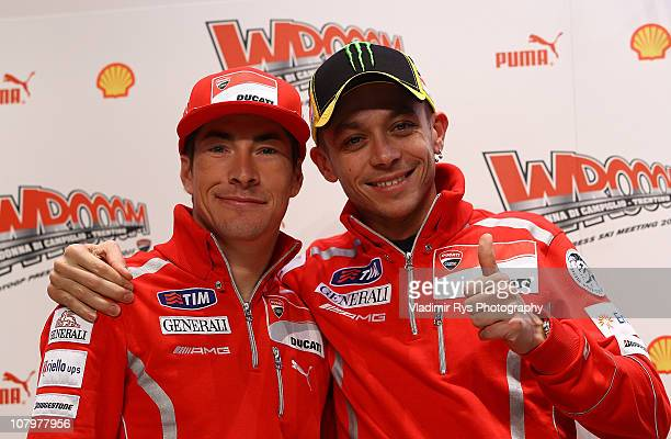 Valentino Rossi of Italy and his team mate Nicky Hayden of the USA and Ducati pose for a picture ahead the press conference of the Ducati Marlboro...