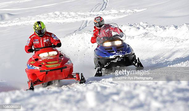 Valentino Rossi of Italy and his team mate Nicky Hayden of the USA and Ducati ride a snow scooter during the 2011 Wroom F1 and Moto GP Press Ski...