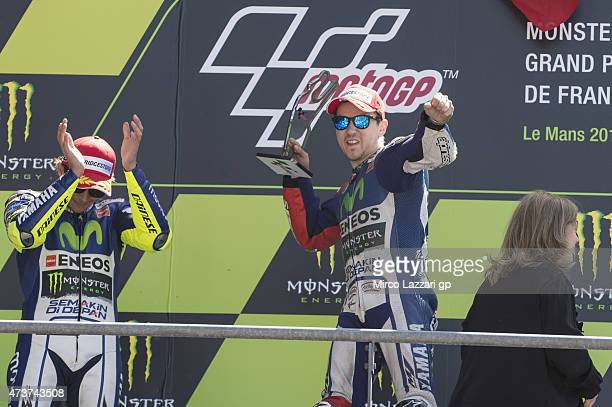 Valentino Rossi of Italy and Movistar Yamaha MotoG Jorge Lorenzo of Spain and Movistar Yamaha MotoGP celebrate on the podium at the end of the MotoGP...