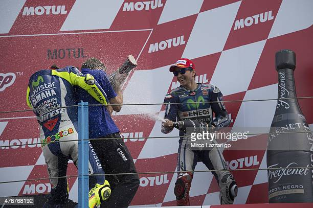 Valentino Rossi of Italy and Movistar Yamaha MotoGP and Jorge Lorenzo of Spain and Movistar Yamaha MotoGP celebrate with champagne on the podium at...