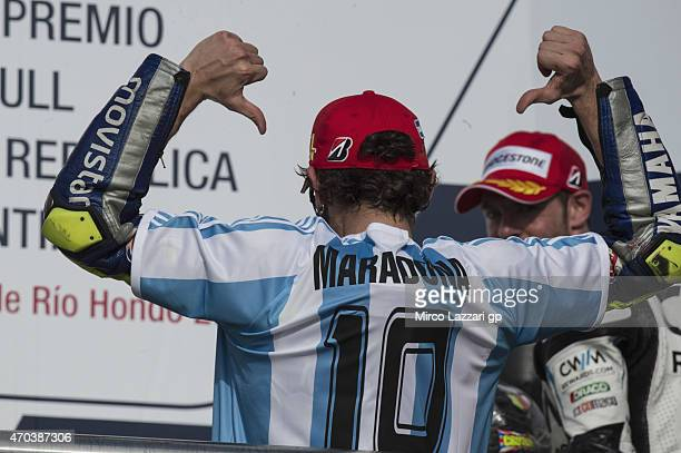 Valentino Rossi of Italy and Movistar Yamaha MotoGP celebrates the victory on the podium at the end of the MotoGP race during the MotoGp of Argentina...