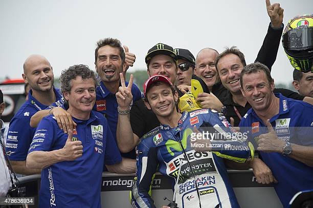 Valentino Rossi of Italy and Movistar Yamaha MotoGP celebrates the MotoGP Pole Position with team at the end of the qualifyng practice during the...