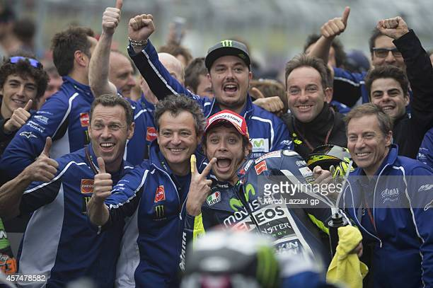 Valentino Rossi of Italy and Movistar Yamaha MotoGP celebrates with team under the podium the victory at the end of the MotoGP race during the MotoGP...