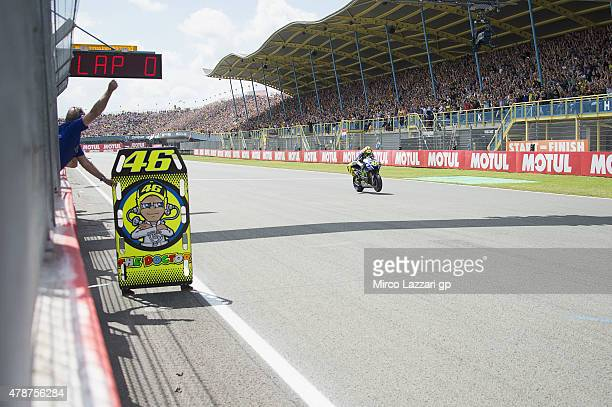 Valentino Rossi of Italy and Movistar Yamaha MotoGP cuts the finish lane and celebrates the victory at the end of the MotoGP race during the MotoGP...