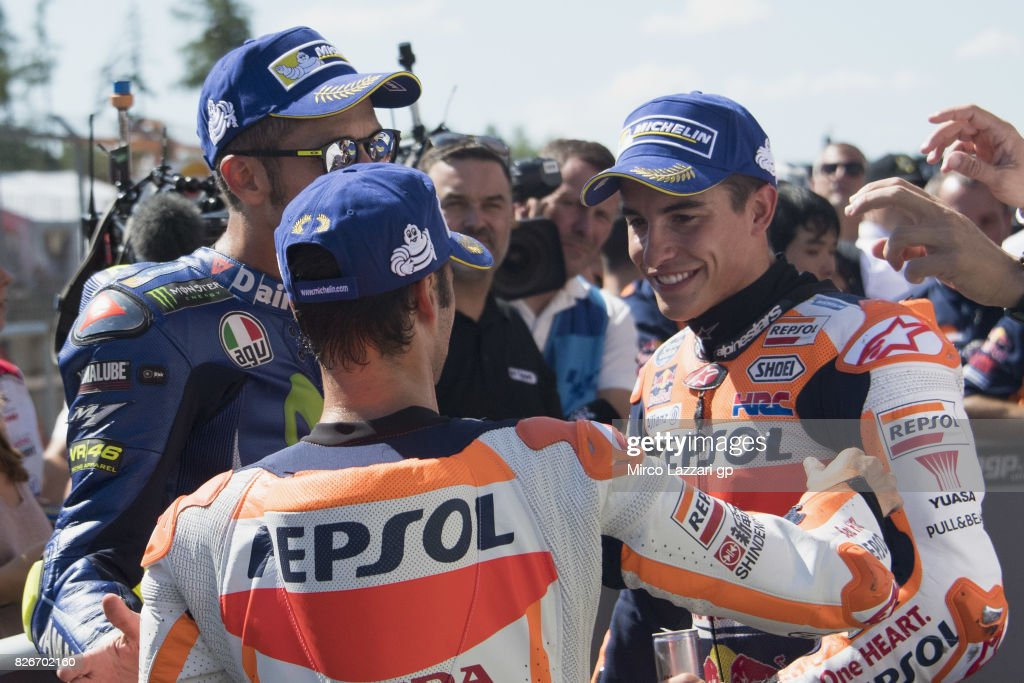Valentino Rossi of Italy and Movistar Yamaha MotoGP, Dani Pedrosa of Spain and Repsol Honda Team and Marc Marquez of Spain and Repsol Honda Team smile at the end of the qualifying practice during the MotoGp of Czech Republic - Qualifying at Brno Circuit on August 5, 2017 in Brno, Czech Republic.