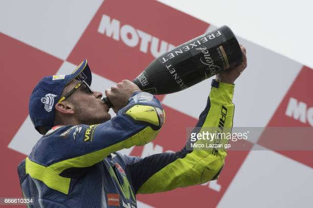 Valentino Rossi of Italy and Movistar Yamaha MotoGP drinks champagne and celebrates the second place on the podium at the end of the MotoGP race...