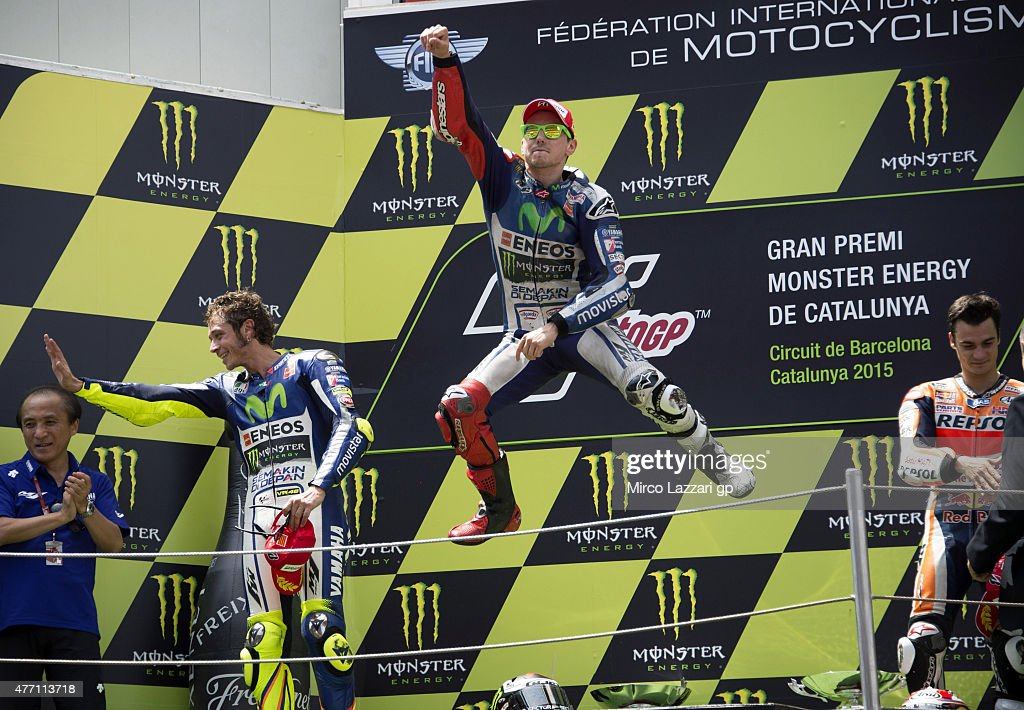 Valentino Rossi of Italy and Movistar Yamaha MotoGP, Jorge Lorenzo of Spain and Repsol Honda Team and Dani Pedrosa of Spain and Repsol Honda Team celebrate on the podium at the end of the MotoGP race during the MotoGp of Catalunya - Race at Circuit de Catalunya on June 14, 2015 in Montmelo, Spain.