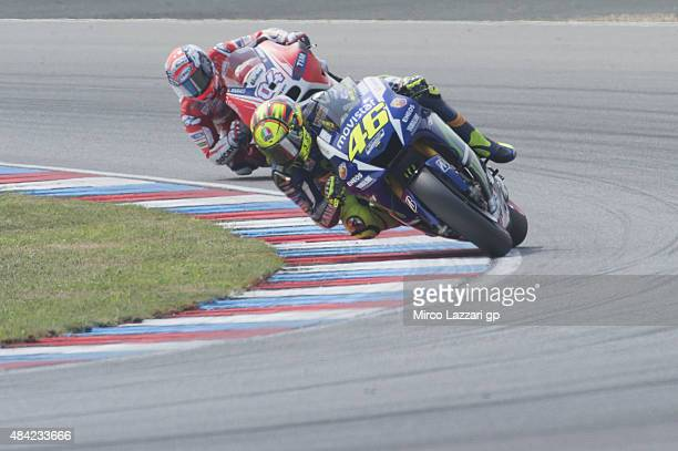 Valentino Rossi of Italy and Movistar Yamaha MotoGP leads Andrea Dovizioso of Italy and Ducati Team during the MotoGP race during the MotoGp of Czech...