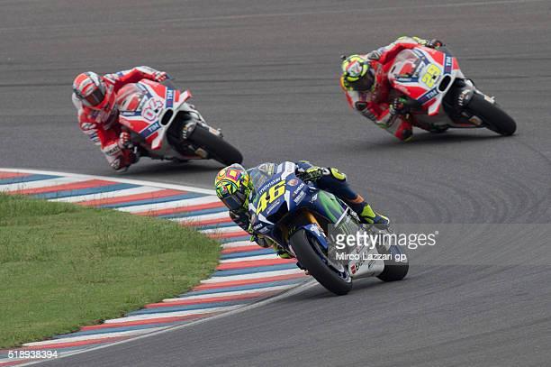 Valentino Rossi of Italy and Movistar Yamaha MotoGP leads Andrea Dovizioso of Italy and Ducati Team and Andrea Iannone of Italy and Ducati Team...