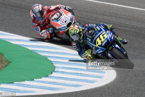 Valentino Rossi of Italy and Movistar Yamaha MotoGP leads Andrea Dovizioso of Italy and Ducati Team during the MotoGP race during the MotoGp of Spain...