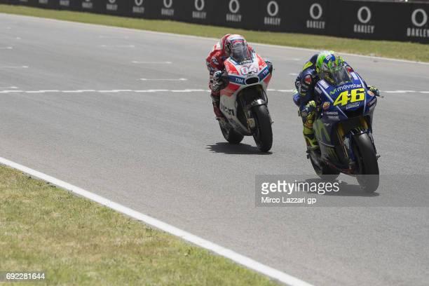Valentino Rossi of Italy and Movistar Yamaha MotoGP leads Andrea Dovizioso of Italy and Ducati Team during the MotoGP race during the MotoGp of Italy...