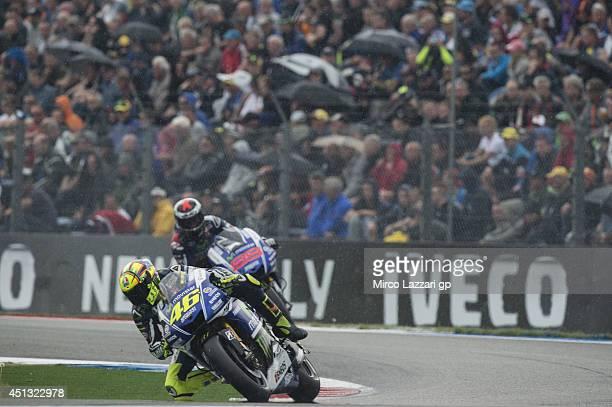 Valentino Rossi of Italy and Movistar Yamaha MotoGP leads Jorge Lorenzo of Spain and Movistar Yamaha MotoGP during the MotoGP of Netherlands...