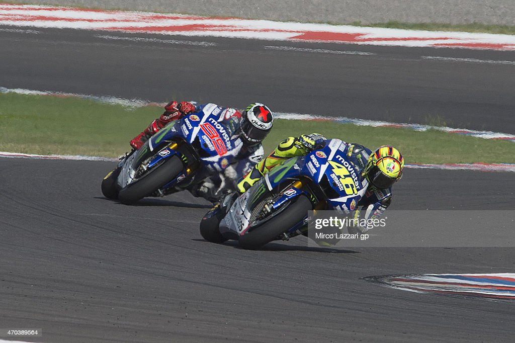 <a gi-track='captionPersonalityLinkClicked' href=/galleries/search?phrase=Valentino+Rossi&family=editorial&specificpeople=157603 ng-click='$event.stopPropagation()'>Valentino Rossi</a> of Italy and Movistar Yamaha MotoGP leads <a gi-track='captionPersonalityLinkClicked' href=/galleries/search?phrase=Jorge+Lorenzo&family=editorial&specificpeople=543869 ng-click='$event.stopPropagation()'>Jorge Lorenzo</a> of Spain and Movistar Yamaha MotoGP during the MotoGP race during the MotoGp of Argentina - Race at on April 19, 2015 in Rio Hondo, Argentina.