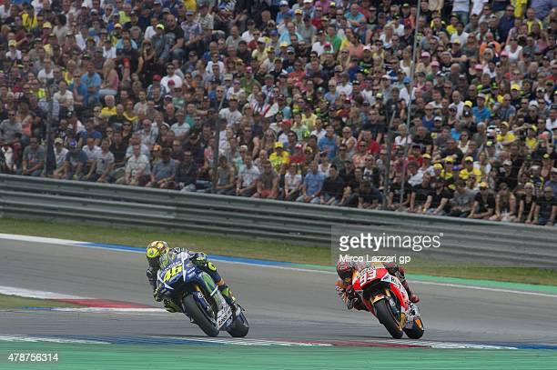 Valentino Rossi of Italy and Movistar Yamaha MotoGP leads Marc Marquez of Spain and Repsol Honda Team during the MotoGP race during the MotoGP...