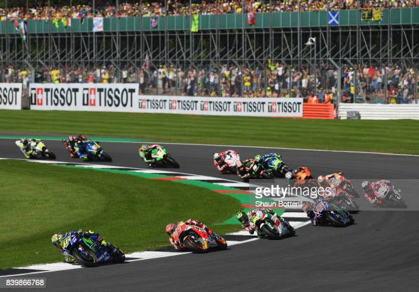 Valentino Rossi of Italy and Movistar Yamaha MotoGP leads on the first lap during the MotoGP of Great Britain at Silverstone Circuit on August 27...