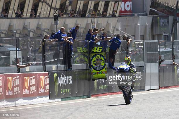 Valentino Rossi of Italy and Movistar Yamaha MotoGP lifts the front wheel and celebrates the second place at the end of the MotoGP race during the...