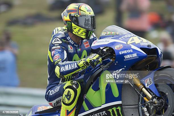 Valentino Rossi of Italy and Movistar Yamaha MotoGP lifts the front wheel during the MotoGP Netherlands Qualifying at TT Assen Circuit on June 26...