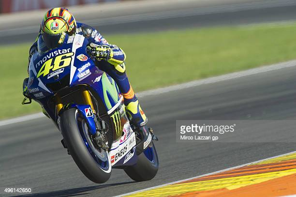 Valentino Rossi of Italy and Movistar Yamaha MotoGP lifts the front wheel during the qualifying practice during the MotoGP of Valencia Qualifying at...