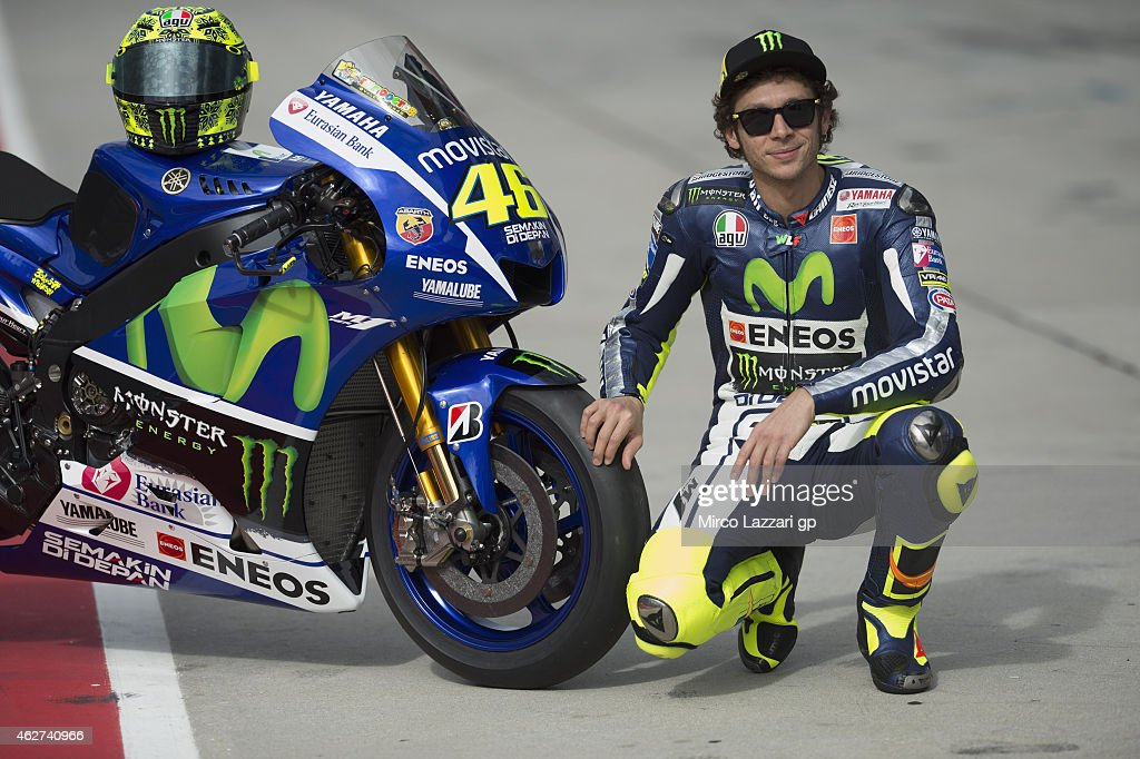 <a gi-track='captionPersonalityLinkClicked' href=/galleries/search?phrase=Valentino+Rossi&family=editorial&specificpeople=157603 ng-click='$event.stopPropagation()'>Valentino Rossi</a> of Italy and Movistar Yamaha MotoGP poses with his bike in pit during day one of the MotoGP tests at Sepang Circuit on February 4, 2015 in Kuala Lumpur, Malaysia.
