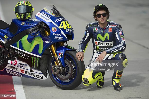 Valentino Rossi of Italy and Movistar Yamaha MotoGP poses with his bike in pit during day one of the MotoGP tests at Sepang Circuit on February 4...