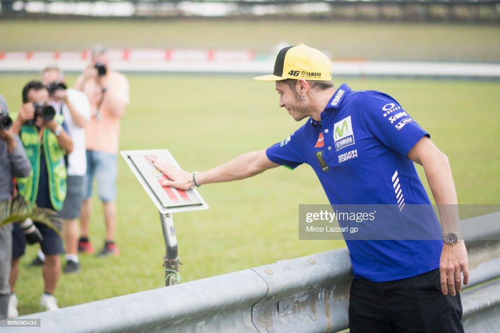 Valentino Rossi of Italy and Movistar Yamaha MotoGP pray during the 'Track walk to Turn 11 for SIC ' ahead of the MotoGP of Malaysia at Sepang Circuit on October 26, 2017 in Kuala Lumpur, Malaysia.